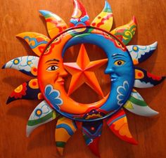 Metal Talavera Mexican sun (with moons and star)- would be fun in a kitchen