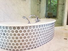 Hexagon glass mosaic from Oceanside Glass Tile.: Apply to door wall, floor, and back wall for a wrapped in jewels effect.