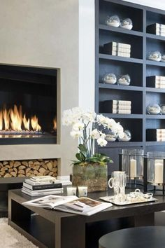 Cool modern fireplace with log storage underneath. Nice built ins too, love the material and color. Home Living Room, Living Spaces, Muebles Living, Fireplace Design, Shelving By Fireplace, Library Fireplace, Open Fireplace, Interiores Design, Built Ins