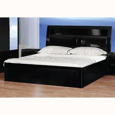 Augment the beauty and coziness of your master #bedroom by placing this comfortable Madrid #doublebed. The #bed comes in black glossy finish that sparks the beauty of every mattress and bed sheet colors.