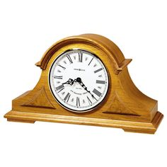 Oak Mantel chiming Clocks,tambour Quartz Mantel Clocks,635106 BURTON This tambour mantel clock features decorative top molding and triangular burl overlays.The off white dial features black Roman numerals, black serpentine hands, a convex glass crystal, and a polished brass tone bezel.Quartz, triple-chime.Volume control and automatic nighttime chime shut-off option.Finished in Golden Oak on select hardwoods and veneers.