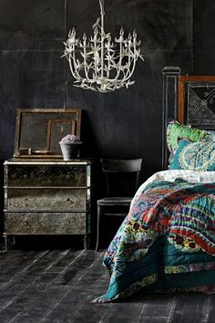 dark boho bedroom with pops of color