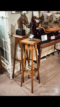 Available in our gallery located at Adjectives Market, Winter Park, FL.  Oak Arts & Crafts Pyramid Stand with Cutouts & Shelf Stretcher and with Button Adornments & Shelf Stretcher.  $169 each    (SOLD the Button Adornments & Shelf Stretcher Stand - Other one still available)