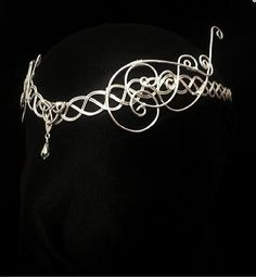 This Is a stunning handmade circlet that slopes to a flattering V shape across the forehead It is made from a thick silver plated wire that is
