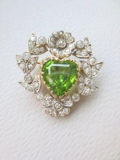 An Edwardian peridot and diamond heart and flowers : Lot 200