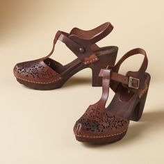 "LACE CUT T-STRAP CLOGS -- Capturing the beauty of falling leaves in laser-cut leather, our graceful clogs are grounded by an elegant, wooden heel. Italy. Exclusive. Euro whole sizes 36 to 41. 36 (US 6.25), 37 (US 7), 38 (US 7.75), 39 (US 8.5), 40 (US 9.25), 41 (US 10). 3-1/2"" heel."
