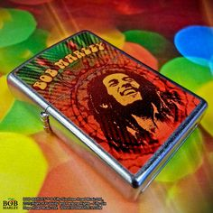 Put your musical taste on display with this Bob Marley windproof lighter. The Satin Chrome finish of this lighter vividly displays a stylized portrait of Bob Marley on this lighter making this a great collectible item for any fan.  #Marley70