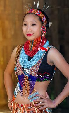 The beautiful women from Wancho tribe clad in their traditional dress who belongs to a state called Arunachal from North East India