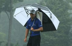 Zach Johnson of the United States waits on the tenth green during the second round of the 95th PGA Championship on August 9, 2013 in Rochester, New York.