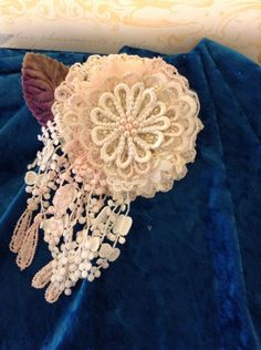 A personal favorite from my Etsy shop https://www.etsy.com/listing/470592770/shabby-chic-flower-brooch-viola