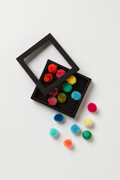pretty office supplies:  push pins/tacks with yarn poms {Anthropologie}