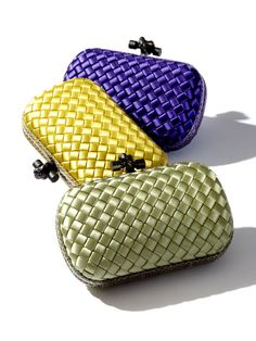 Add a pop of color with a Bottega Veneta woven clutch.