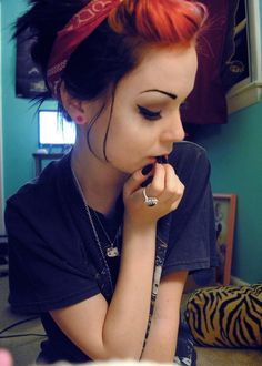 Great eye make up for our women in this world (if a little too clean); I like the hair color & bandana, too.