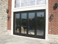 This gorgeous #GTA #home features a highly functional and aesthetically pleasing #custom #Amberwood #Panoramic #Bifolding #Door, allowing for a seamless transition on to a lovely #patio!