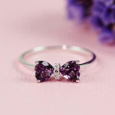Silver Amethyst & White CZ Bow Ring Ring size: 9 (specify your size when order) Approx. measurement: x Material: sterling silver, amethyst, white cz Item 13198 Cute Rings, Pretty Rings, Beautiful Rings, Bow Rings, Unique Rings, Cute Jewelry, Jewelry Rings, Jewelry Accessories, Jewelry Design