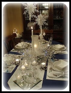 Love the dark blue table cloth with the silver and white dinnerware and accents
