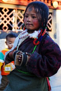 Little pilgrim in Tibet by milopeng - The spot on her forehead was cause by prostating all five - 4 limbs and head on the floor.  #world #cultures