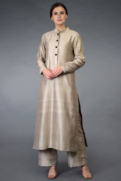 Presenting a classic chic beige suit crafted in luxurious pure raw silk. Available online and in-store www. Designer Dress For Men, Indian Designer Suits, Designer Dresses, Silk Kurti Designs, Kurta Designs Women, Indian Dresses, Indian Outfits, Pure Georgette Sarees, Wedding Dress