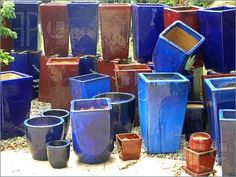 collection of different coloured plant pots