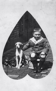 Elie MauritsWeijl (1917-1943) in Oldenzaal, The Netherlands, with his dog and puppies, names unknown.