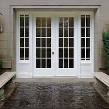 The Elegant White Double French Door Entranceway Above Is Very Simplistic.  A Statement In Itself, The Stone Walkway Leading Up To The Doors, ...