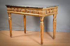 Rectangular #console in carved #giltwood with interlacing foliage motifs. Veined grey #marble top. #Italy, late #18th century. For sale on Proantic by Pierre Parenthou Antiquités.