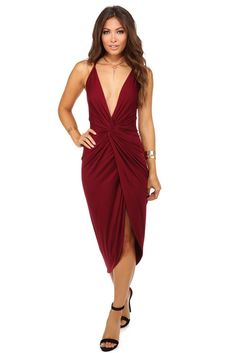 <p>Sometimes things get a bit tangled and that's okay! This maxi dress features a V neck with a knotted front, a thin strap X back and a cute wrap skirt.</p>