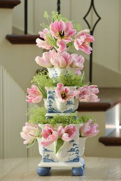 This stunning tiered tower of three vases was inspired by the Tulipieres of the 12th century. Display your own beloved stems in this blossoming sculpture for a fresh dose of timeless beauty.