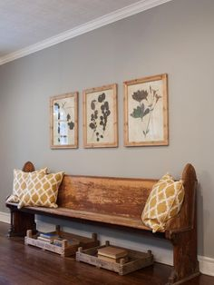 An antique bench is a focal point in the home's entryway.