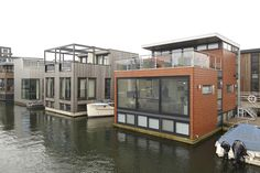 "Another section of floating homes in IJburg. Developer Ton van Namen says many of IJburg's floating homes, which range from 1,200 to 1,600 square feet, were sold before they were built, with asking prices ranging from $520,000 to $650,000. He says prices have fallen about 10% since completion in 2010. He says floating homes have a ""niche"" appeal in the Netherlands."