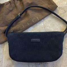 Gucci Black Monogram Shoulder Bag Gucci Black Monogram Shoulder bag. Authentic. Used but in good condition. Comes with dustbag. Length is 9 inches. Height is 5 inches. Strap drop is 7 inches. Some light make up stains inside. Gucci Bags Shoulder Bags