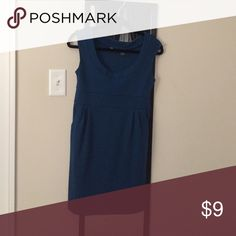 Turquoise dress Dress it up and wear it to work or dress it down. Has pockets worn a few times. No flaws Wet Seal Dresses