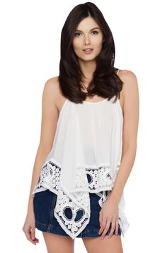 AKIRA's Gypsy Soul Top in White features a scoop neckline, double shoulder straps with tie at top back, a rectangular body with pointed crocheted hems. Free standard U.S. shipping $75+.