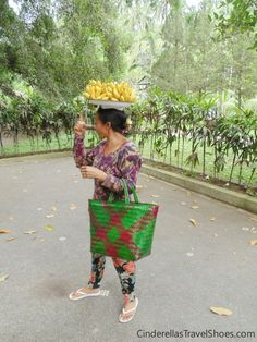 Woman selling bananas, you can get them for 4000 IDR only