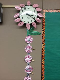 Added minute petals to my clock & the stem is our class jobs. I will be updating the stem to actually look like a stem with numbered leaves hot glued to a clothespin.
