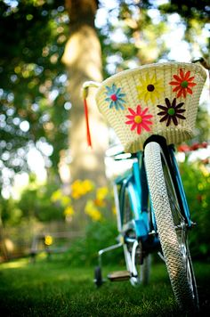 I had a basket just like this on my bike when I was a kid.  My bike was bright pink with flowers on the banana seat.