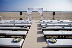Gorgeous plush bench seating for an outdoor beach ceremony #wedding