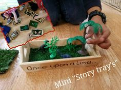 """We bought these small trays by mistake, thinking that we had ordered big ones! No matter, as we brainstormed them into miniature role play story trays. I etched """"once upon a time"""" and Jass added the offcut fake astro turf. Just add miniature figurines, plants, stones etc.."""
