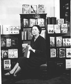 Margaret Mitchell with copies of Gone With the Wind in many languages.