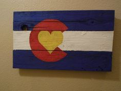 Colorado flag painted on recycled fence / recycled wood