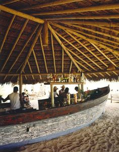 An old fishing boat is the bar at the Uxua pousada.