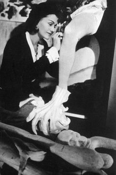 1940 - Coco Chanel putting the last touches on the costume of Mad King Ludwig of Bavaria for Salvador Dalis Bacchanale,