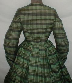 "Striking 1860's Green Black Plaid Silk Vintage Dress | eBay seller fiddybee; two piece dress; trimmed w/ green silk & black velvet ribbon; piping at neck, armscyes & waist; bodice & skirt fully lined in cotton; underarm discoloration; bust: 34""; skirt waist: 26""; skirt length: 40""; hem width: 112"""