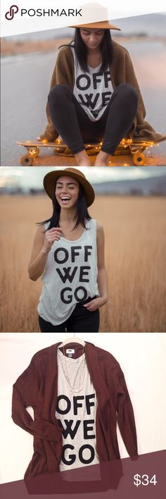NWT OFF WE GO loose fit cutoff tank NWT- never worn, tags still on and cool branding sticker included! Size small- loose, oversized fit as seen in pics! 3rd pic is of the item I have! indybrand Tops Tank Tops