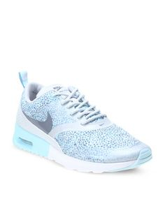 These Nike Air MaxThea Print Sneakers are a must-have for any woman. Trendy, stylish andcomfortable the design boasts an ice-white and blue colour combination, spottedpatter, criss-cross laces, textile uppers, rubber soles and slim fit huggingthe ankles for support and protection. These lightweight and comfortablesneakers are ideal for everyday wear. Pair them with cute shorts and a T-shirtfor a casual summer day or with stone-wash skinny jeans, jersey and scarf for achilly winter day.