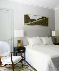 The all-white bedroom of fashion designer Andrew Gn's dreamy Parisian retreat.