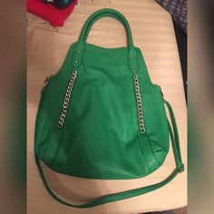 Green CARLOS SANTA purse Green purse with silver chain detail, vaguely used, shoulder strap included in good condition, red inside Carlos Santana Bags Shoulder Bags