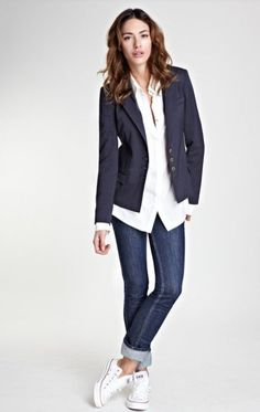 Wear a navy blue blazer jacket and navy slim jeans for a refined yet off-duty ensemble. A pair of white low top sneakers will be a stylish addition to your outfit. Shop this look on Lookastic: https://lookastic.com/women/looks/navy-blazer-white-dress-shirt-navy-skinny-jeans/11167 — Navy Blazer — White Dress Shirt — Navy Skinny Jeans — White Low Top Sneakers
