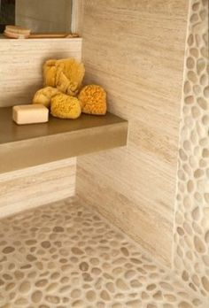 Vein cut Travertine, Pebble rock walls and floor, honed concrete shower bench ---Ashley Campbell Interior Design