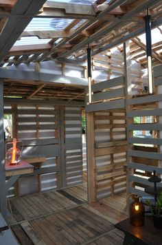 The homes made from discarded pallets that could house the world: Remarkable hand-built structures could transform developing countries The homes are constructed out of the 150 million pallets that end up in landfills in the U. each year Recycled House, Recycled Pallets, Wood Pallets, Recycled Wood, 1001 Pallets, Recycled Materials, Pallet Benches, Pallet Tables, Pallet Lounge
